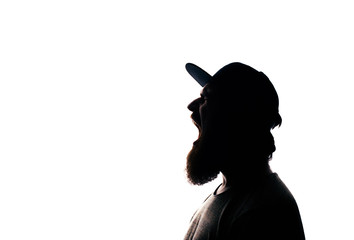 Silhouette of handsome screaming bearded man on white background