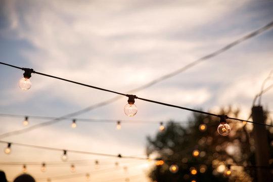 Rows of light bulbs against overcast sky