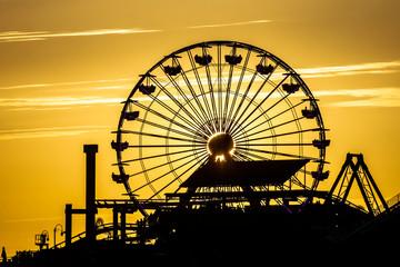 Ferris wheel eclipse sunset