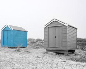 Findhorn, Scotland - July 2016: Colourful beach huts along the coast at Findhorn Bay in Northern Scotland among the sand dunes