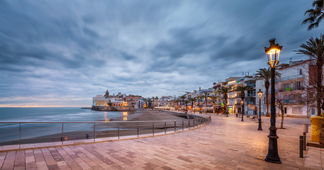 beach walk at sunset in playa san sebastian Sitges catalunya spain