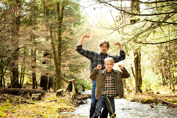 Portrait of father with son ( 8-9 ) in forest