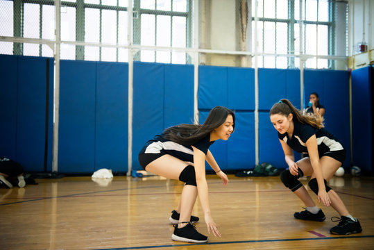 Volleyball players in sports hall