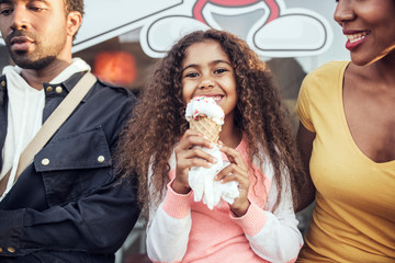 Portrait of girl eating ice cream outdoors