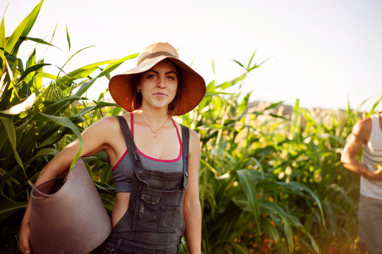 Portrait of young woman standing in field