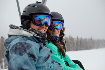 Young couple in ski goggles on lift