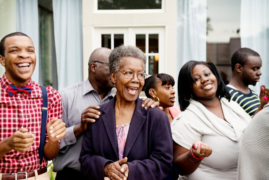 Smiling multigenerational family standing outdoors