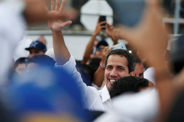 "Venezuelan opposition leader Juan Guaido, who many nations have reconigzed as the country's rightful interim ruler, attends the ""Venezuela Live Aid"" concert at the Tienditas cross-border bridge between Colombia and Venezuela, in Cucuta"