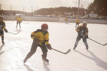 Boys (10-11) playing ice hockey