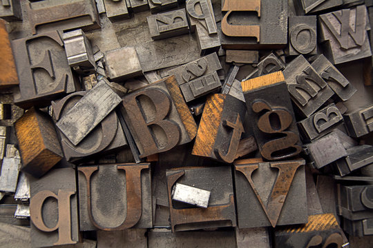alphabet letter press background with old type lettering