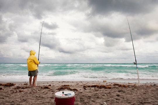 Fisherman looking at sea