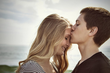Husband kissing his wife (16-17) on forehead