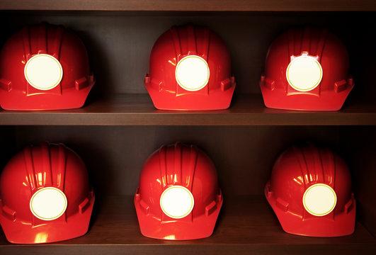 Factory worker's hard hats on shelves