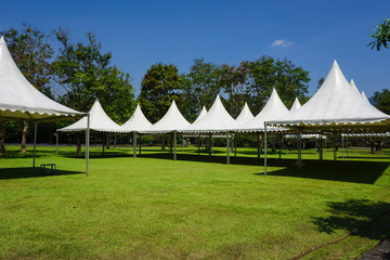 white tent in line in the garden park for gardening party - photo indonesia bogor Wall mural