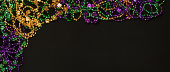 Purple, Gold, and Green Mardi Gras beads background