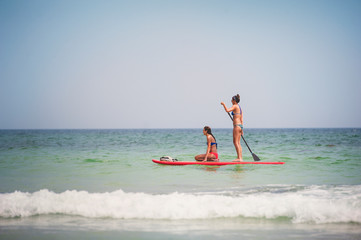 Two young women on paddleboard