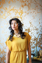Portrait of young woman in yellow dress