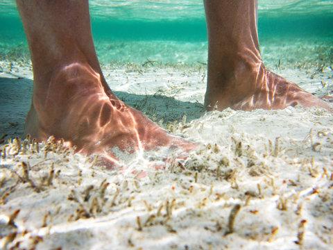 Underwater view of man's feet