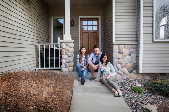 Mother with son and daughter (16-17) on porch