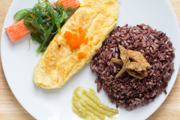 Rice with omelette on plate