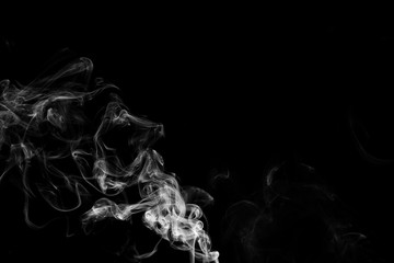 Smoke the white incense on a black background. darkness concept