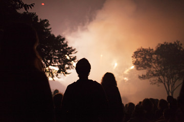 Silhouette of couple looking at firework display