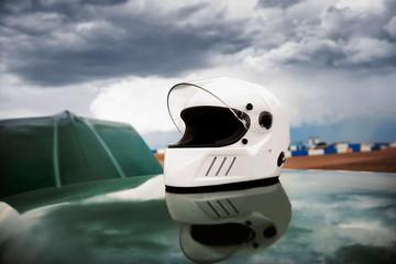 Helmet on roof of racecar