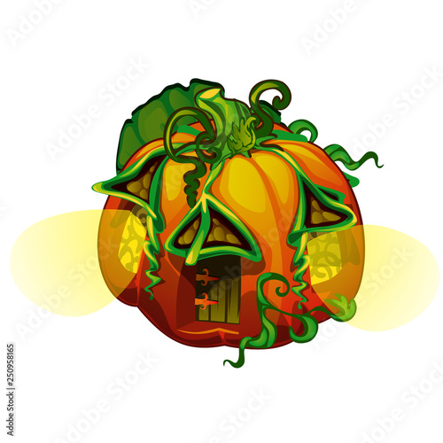 Fairy house in form of ripe pumpkin with glowing windows