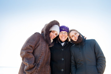 Mother with two adult daughters in winter