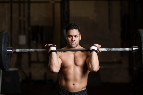 Man preparing to lift weights over his head