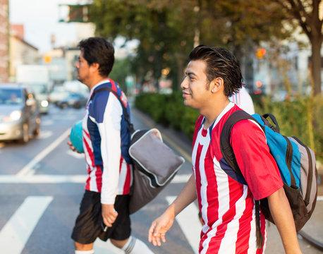 Soccer players crossing street