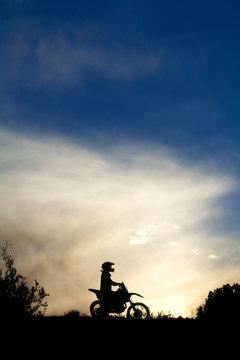 Silhouette of motocross rider