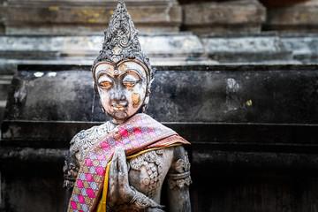 kind of vintage buddhism statue.