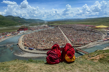 Tibetan monks sitting on the hill