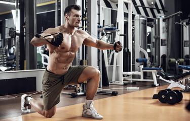 guy bodybuilder with exercise machine