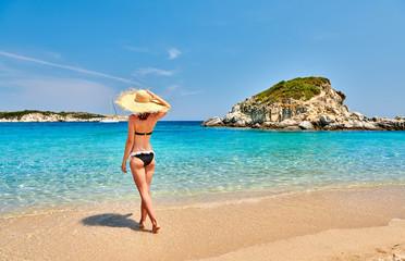 Wall Mural - Woman in bikini on beach