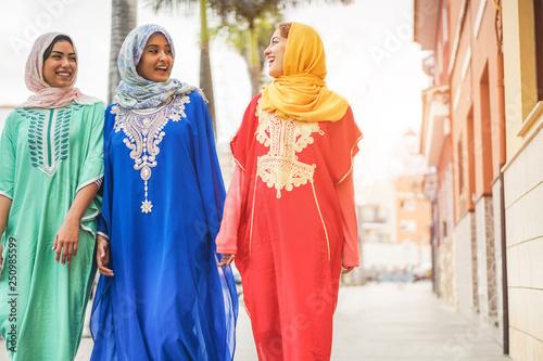 Happy arabic friends walking in city center - Young arabian