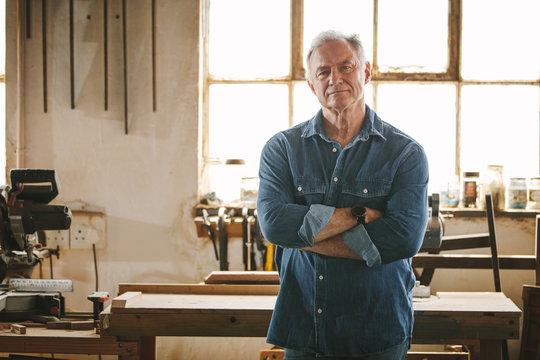 Portrait of confident senior male carpenter