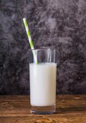 Spoed Foto op Canvas Glass of Milk With Straw