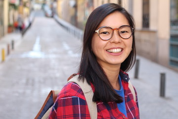 Asian woman smiling in the city