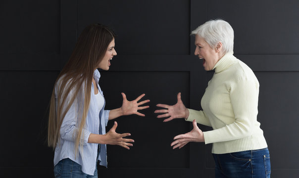 Mother and daughter yelling at each other, having quarrel
