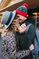 True love emotions of joyful cute couple enjoying time together outdoor in city. Lovely happy moments, having fun, smiling, christmas time, dating, falling in love