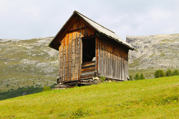 A small typical wooden hut in the Prato Piazza plateau, Dolomiti, Italy