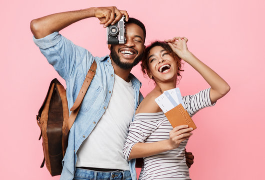 Happy african-american couple ready for vacation, crop