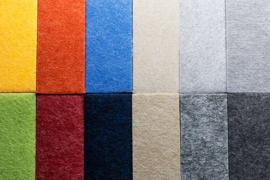 Sample of multi-colored materials for soundproof wall paneling in interior decoration.