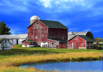 red barns against deep blue sky