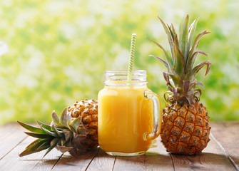 Foto op Canvas Sap glass jar of pineapple juice with fresh fruits