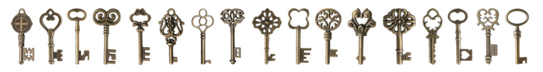 Set of bronze vintage ornate keys on white background