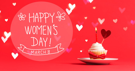 Women's Day message with cupcake and heart ornament