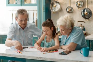 Grandparents teach a kid